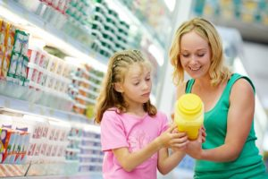 mother daughter checking product label